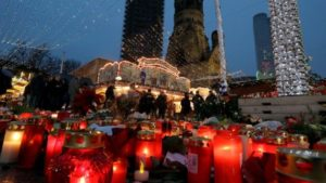 a-makeshift-memorial-of-candles-and-flowers-lies-at-the-breitscheidplatz-market-in-berlin