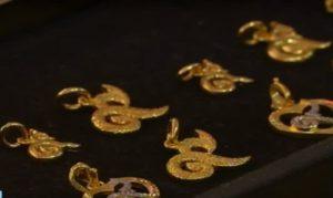 Gold pendants shaped as Thai number nine