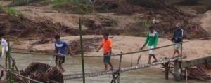 Makeshift bridge in flooded southern Thailand