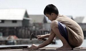 Koh Panyee boy building the football platform