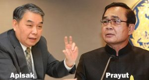 Prime Minister Prayut Chan-o-cha, right, and Finance Minister Apisak Tantiworawong