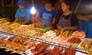 Woman selling sweet pastry at the Kata night market. Have to say I prefer this one over Beijing's similar night market: