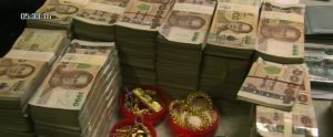Cash and gold seized from drug suspect