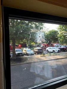A bullet hole is seen in a window after a gunman opened fire on Republican members of Congress during a baseball practice near Washington in Alexandria, Virginia, June 14, 2017, in this picture obtained from social media. COURTESY TWITTER/@JOEMISCAVIGE/via REUTERS