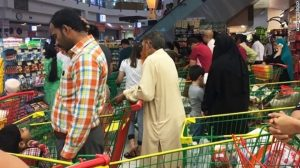 People shopping for food in Qatar