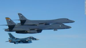 US bombers and Japanese fighters fly together