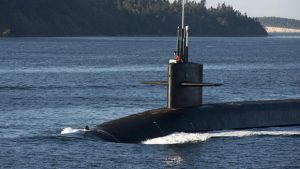 PUGET SOUND, Wash. (Sept. 28, 2016) The Gold Crew of the Ohio-class ballistic-missile submarine USS Kentucky (SSBN 737) transits the Hood Canal as the boat returns home to Naval Base Kitsap-Bangor following a routine strategic deterrent patrol. Kentucky is one of eight ballistic-missile submarines stationed at the base, providing the most survivable leg of the strategic deterrence triad for the United States. (U.S. Navy photo by Petty Officer 1st Class Amanda R. Gray/Released)